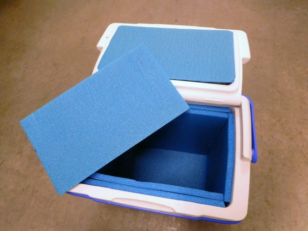 Pieces of blue foam insulation were added to a small cooler to make ice last longer.