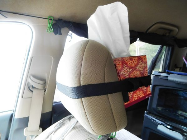 Tissue box strapped to a headrest