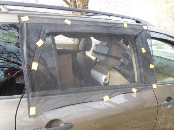 Magnetic car window screen setup