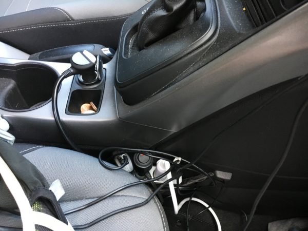 The 12-volt cord management area by the front passenger seat.