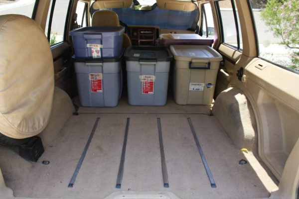 Filling the belly of the beast: start by loading the tubs toward the front of the cargo area. Water containers go in next.