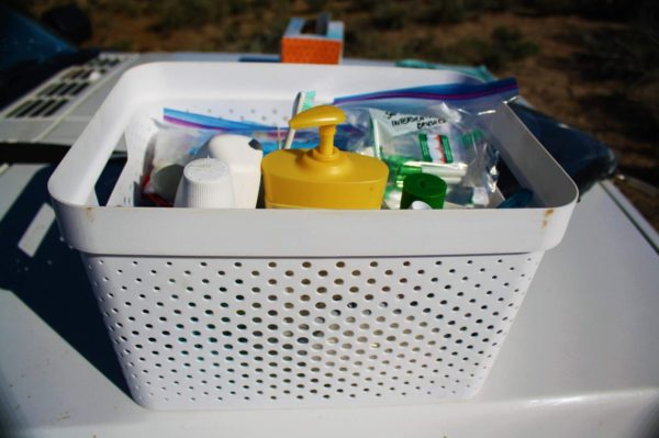 Medicine man: I pack my health-related items in a small tub which I store in the front seat on top of the office tub. Use cups to compartmentalize small items so your medicine chest doesn't turn into a tossed salad of toiletries.