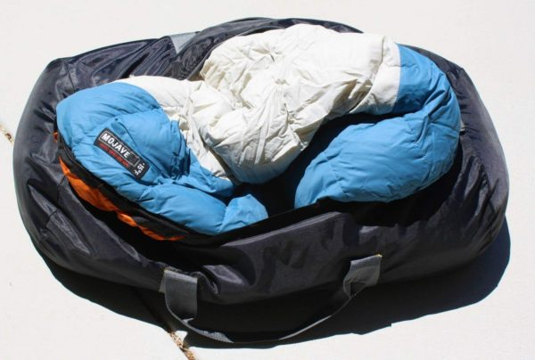 The mummy: store your sleeping bag in a duffel bag. There are actually two sleeping bags in there, which come in handy when fall arrives. I can also pack the extra one in my backpack the day before leaving for a trek, and still have another to sleep in that night near the trailhead.