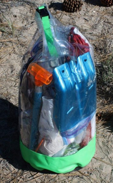 High and dry: I store my backpacking (and ski mountaineering) gear in this vinyl, see-through dry bag when I'm not out in the wilds. I can leave it outside at night along with the tubs knowing the contents are protected from rain and moisture.