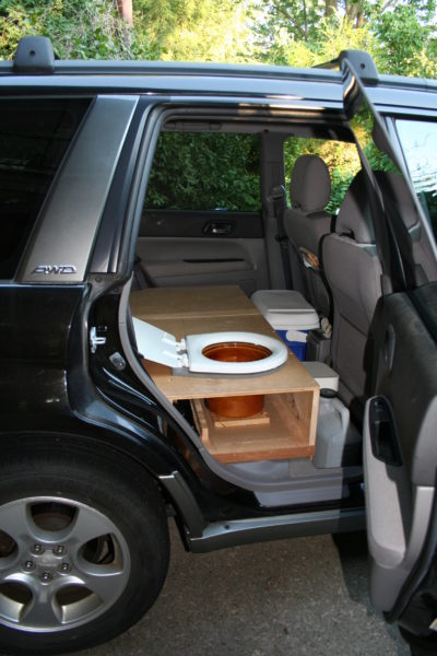A toilet installed in a Subaru Forester.