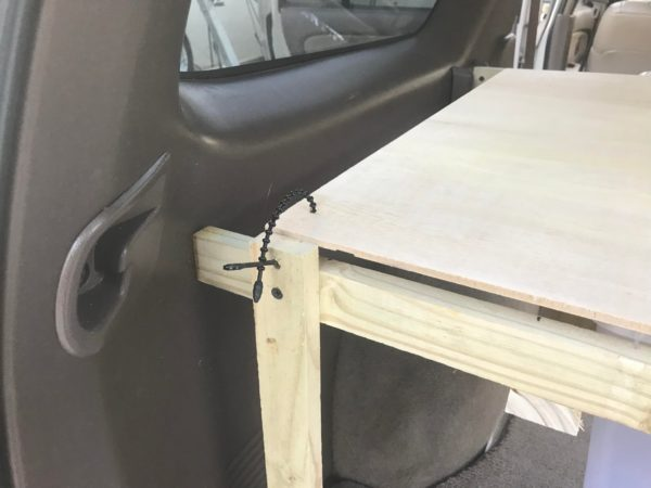 Storage shelf build in the back of a 1998 Toyota 4Runner