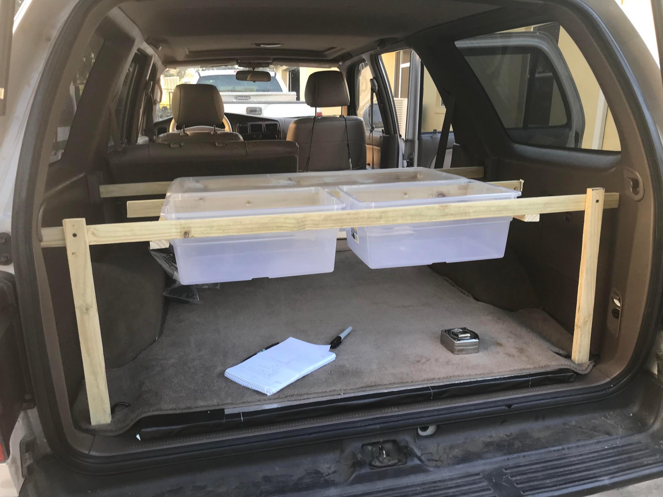 A Storage Shelf Built Into A 1998 Toyota 4runner Suv Rving